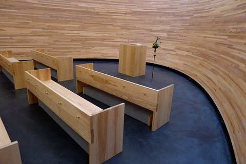 In the first few rows there are kneelers under the benches