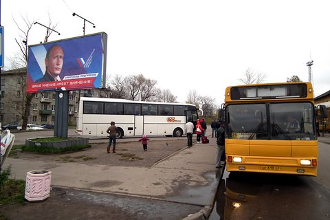 Express bus from St Petersburg and a local yellow bus