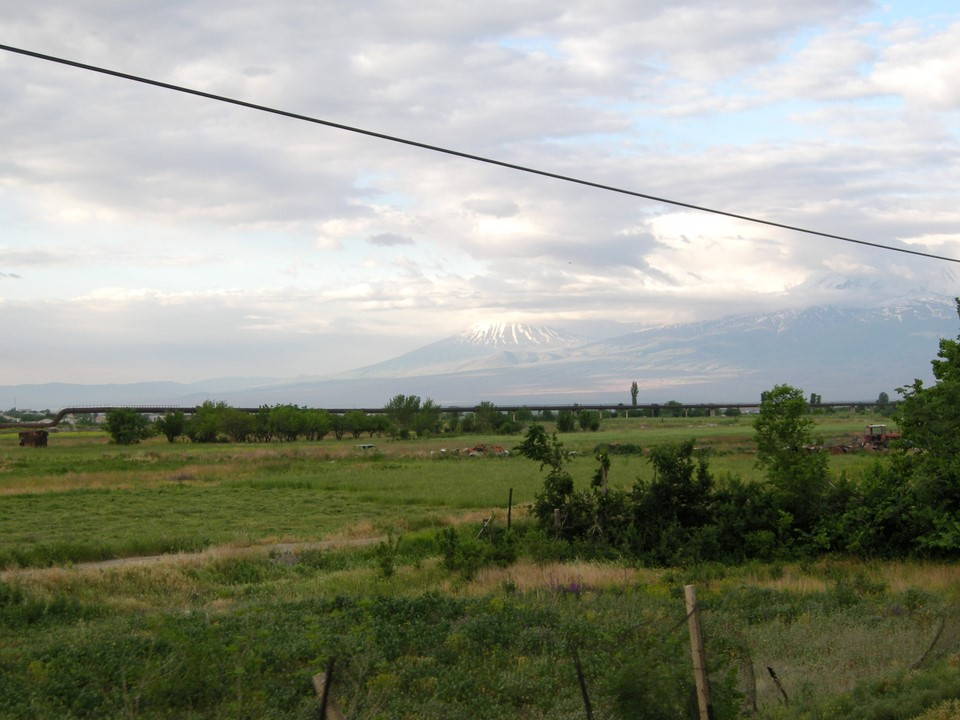 Mount Ararat can barely be seen behind the plain