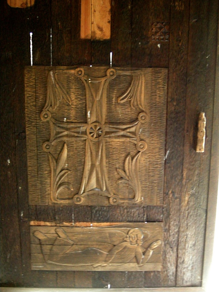 Wooden carvings on the door of the dining hall