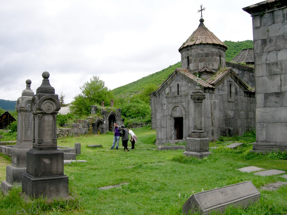 A small chapel and tourists in front of it