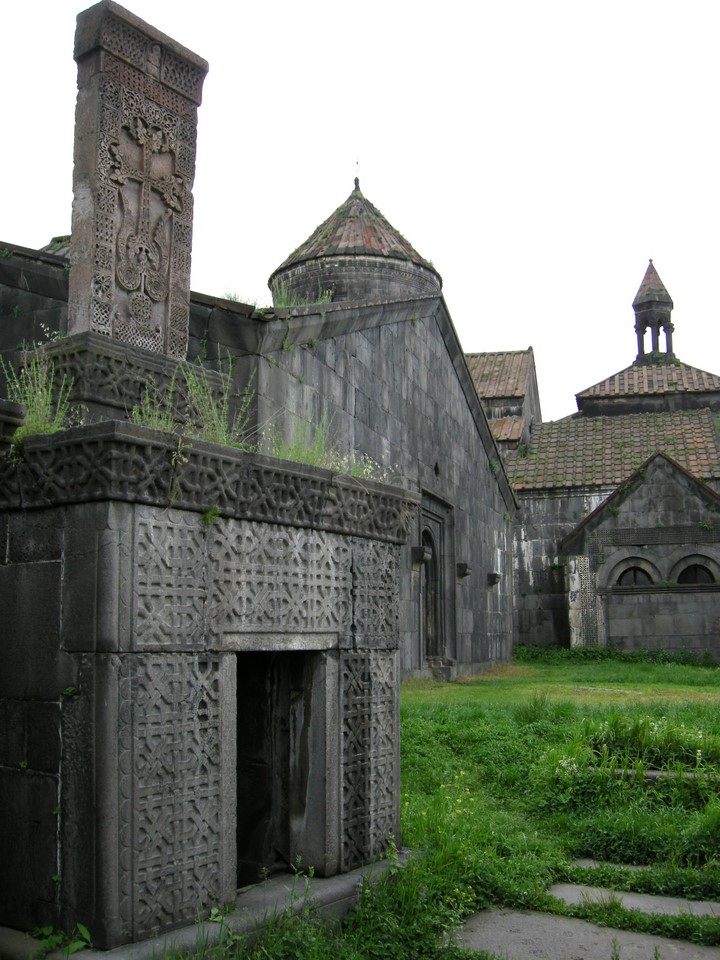 One khachkar stone cross on the roof of a praying room