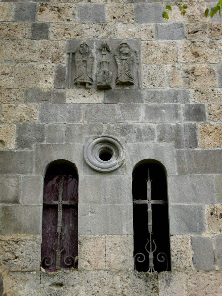 Windows and a relief on the wall