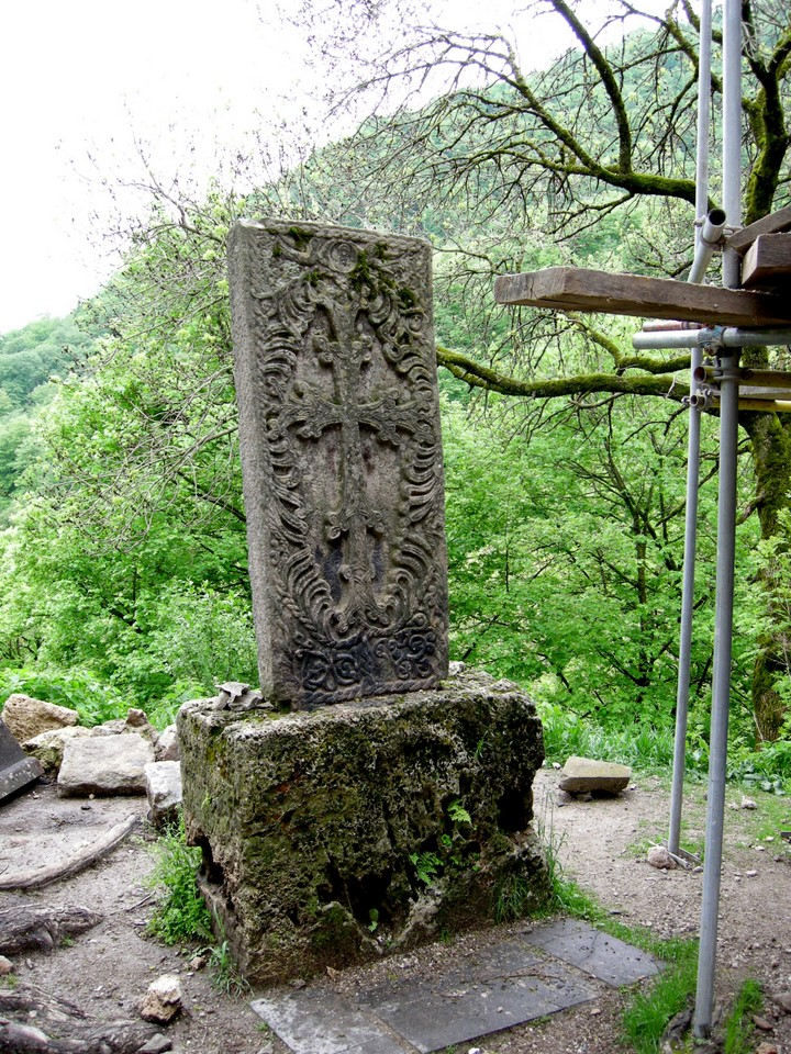 A khachkar stone cross next to the monastery church