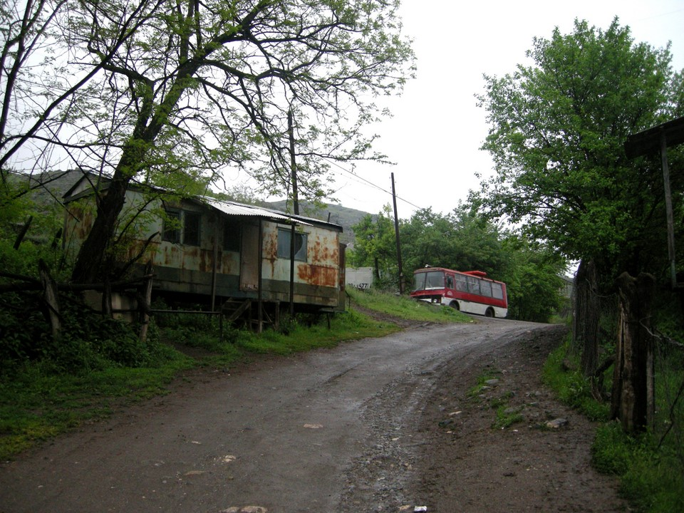 A domik (container house) with the Ijevan bus in the background