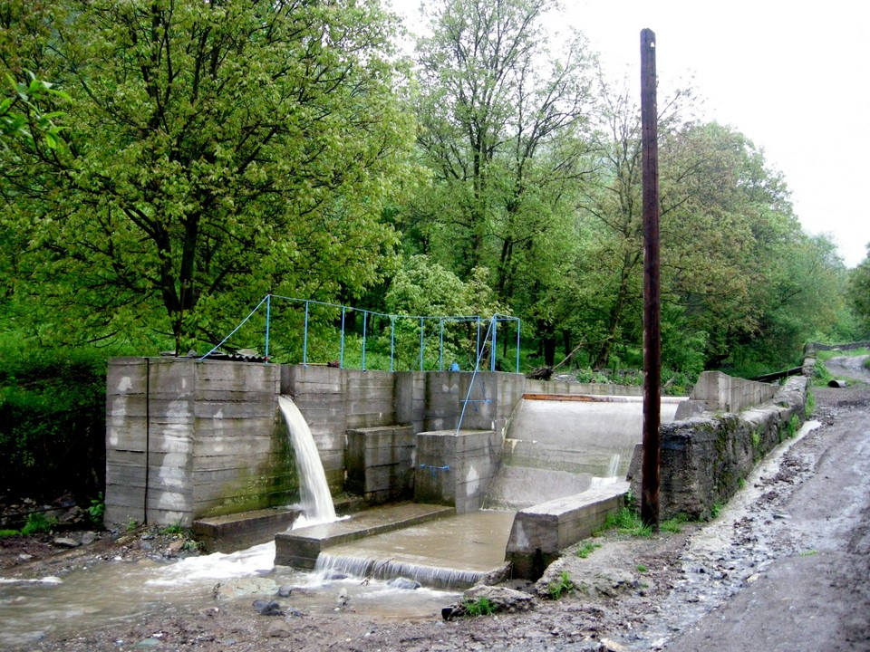 There is a small hydropower plant at the river flowing through the village