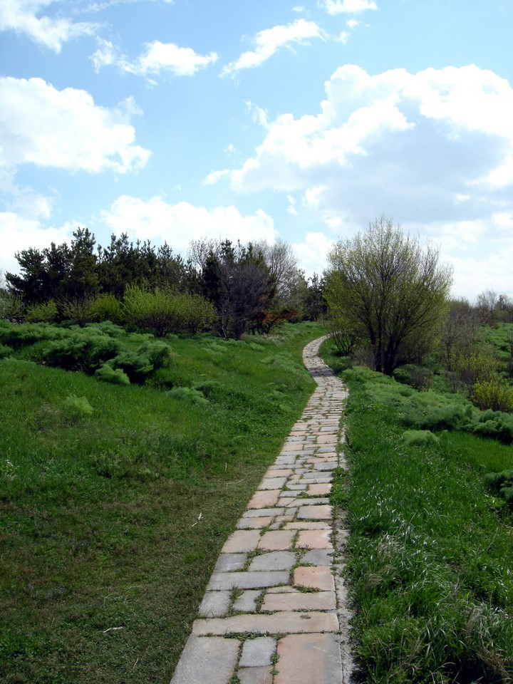 Stone-covered path to the peak of the hill