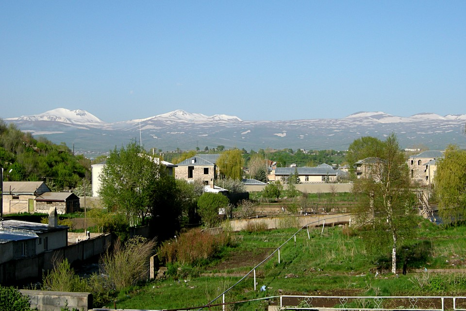 View over city to the Geghama mountain range