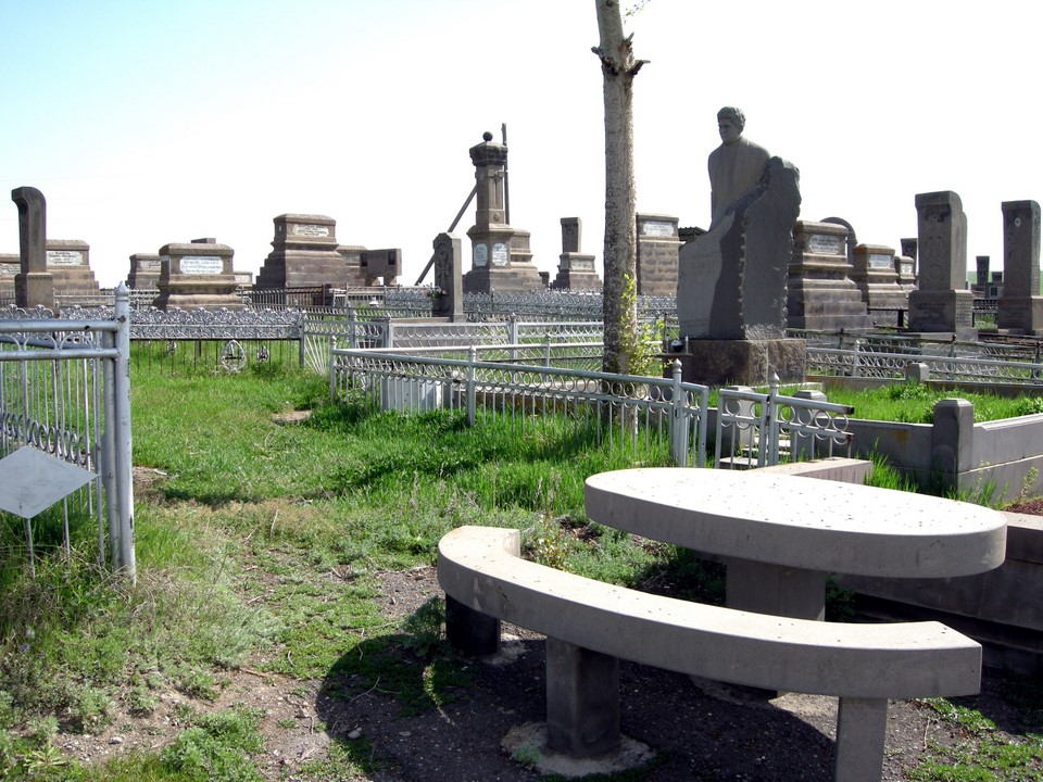 Many graves have picnic tables next to them