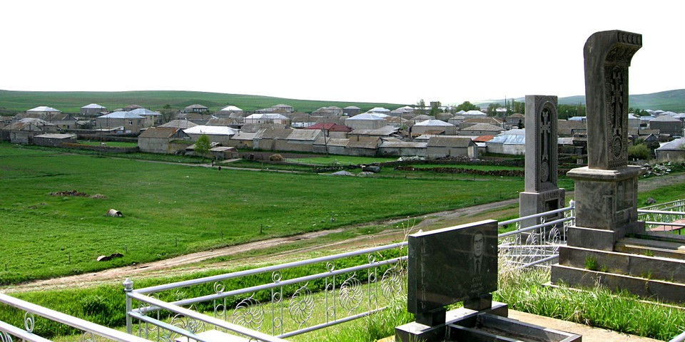 Village continues also to the other side of the cemetery
