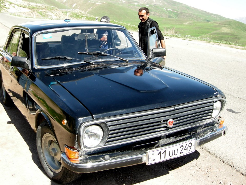 Our driver and his GAZ-24 Volga
