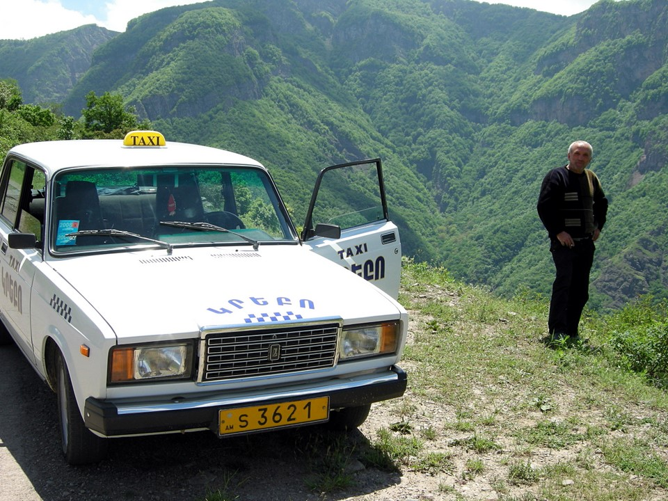 Our driver with his Lada taxi