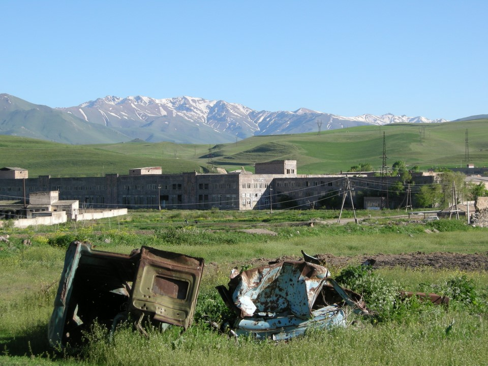 Buildings and scrap at edge of the town