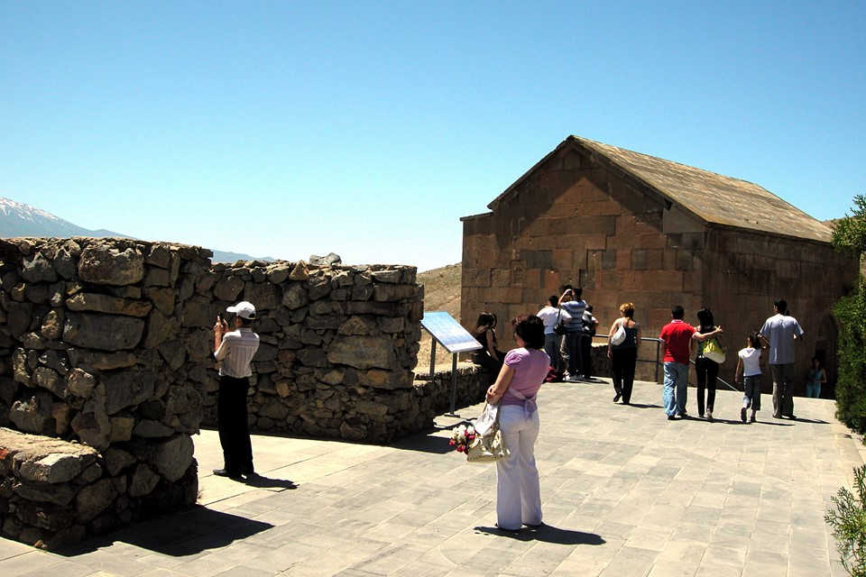 People standing on the monastery wall