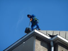 Removing snow from the roof in Kallio