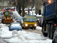 Cars being towed to make space for a snow plough
