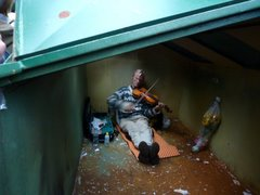 Violinist in a dustbin