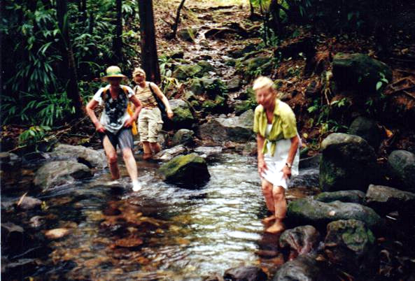 Jatta, Tiina and Likki crossing a river (Roseau Valley, Dominica)