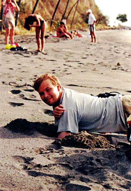 Niko digging a sand sample (L'Anse Turin)